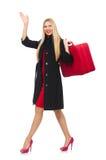 Die recht blonde Frau, die Koffer lokalisiert auf Weiß hält Lizenzfreies Stockfoto