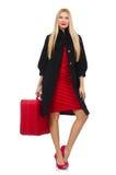 Die recht blonde Frau, die Koffer lokalisiert auf Weiß hält Lizenzfreies Stockbild