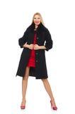 Die recht blonde Frau im schwarzen Mantel lokalisiert auf Weiß Lizenzfreie Stockfotografie