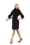 Die recht blonde Frau im schwarzen Mantel lokalisiert auf Weiß Lizenzfreies Stockbild