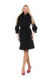 Die recht blonde Frau im schwarzen Mantel lokalisiert auf Weiß Lizenzfreie Stockbilder
