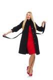 Die recht blonde Frau im schwarzen Mantel lokalisiert auf Weiß Lizenzfreies Stockfoto