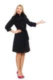 Die recht blonde Frau im schwarzen Mantel lokalisiert auf Weiß Stockbild