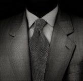 Die Reihe des Mannes im Schwarzen Lizenzfreie Stockbilder