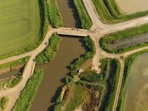 Die Reisfelder werden mit Wasser überschwemmt Überschwemmte Reispaddys Landwirtschaftliche Methoden des Anbauens des Reises auf d Lizenzfreie Stockfotos