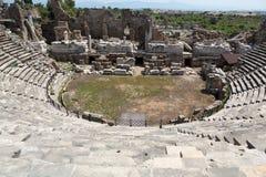 Die Ruinen des alten römischen Amphitheatre in der Seite Lizenzfreies Stockfoto