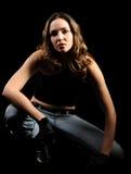 Die schöne Frau auf einem schwarzen Hintergrund Lizenzfreie Stockbilder