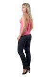 Die schöne junge Frau in den schwarzen Jeans Lizenzfreies Stockbild