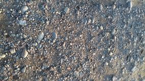 Die schönen smoll Steine auf Strand lizenzfreies stockfoto