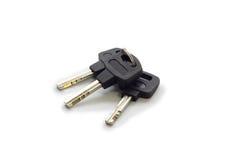 Die Schlüssel auf weißem Hintergrund Stockfotografie