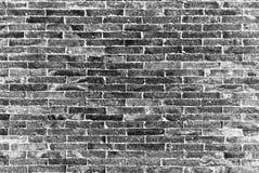 Die schwarze Ziegelsteinwand lizenzfreies stockfoto