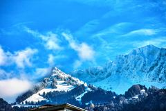 Die Schweiz-Berg mit Schnee umfasste Spitzen Lizenzfreies Stockfoto