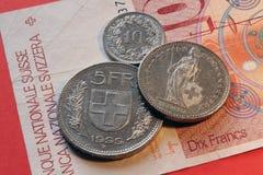 Die Schweiz, Frankenmünzen und Banknote Stockbild