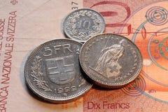 Die Schweiz, Frankenmünzen und Banknote Lizenzfreie Stockbilder