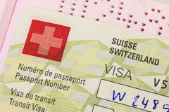 Die Schweiz-Visum im Pass Stockfotografie