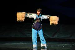 Die schwere Last von Frau Jiangxi-Oper eine Laufgewichtswaage Stockbilder