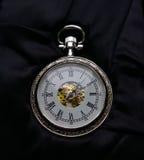 Die silberne Taschenuhr Stockbild