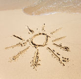 Die Sonne - eine Abbildung auf Sand Lizenzfreie Stockbilder