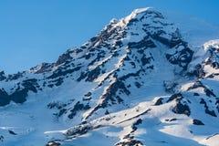Die Sonne stellt über Berg Rainier National Park, Washington, US ein Lizenzfreie Stockfotos