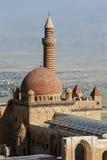 Die Sonnenaufgänge über der großartigen Haube und dem Minarett Ishak Pasa Palaces nahe der modernen Stadt von Dogubayazit in der  Stockfotografie
