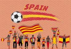 Die spanischen Fußballfane, die mit Spanien zujubeln, kennzeichnen Farben in vorderem O lizenzfreie abbildung