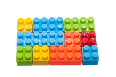 Die Spielwaren der bunte Kinder, Plastikbausteine Stockbilder