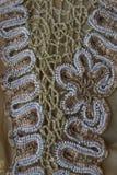 Die Spitze mit den Perlen handgemacht Stockfotos