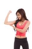 Die sportliche Frauenvertretung, ihr Bizeps überprüfend bewaffnen Muskel Stockbilder
