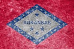 Die Staatsflagge des US-Staats Arkansas herein gegen einen grauen Textillappen am Tag der Unabhängigkeit in den verschiedenen Far stock abbildung