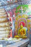 Die Statue von Ananda in der Höhle von Dambulla Lizenzfreie Stockfotografie