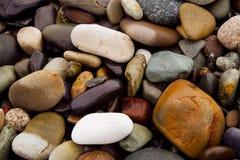 Die Steine auf der Strandnahaufnahme Stockfoto