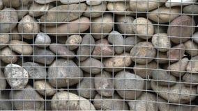 Die Steine im Gitter stock footage