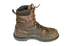 Die Stiefel der alten braunen ledernen Männer Stockfotografie