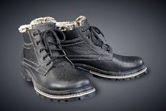 Die Stiefel der schwarzen ledernen Männer Stockfotografie