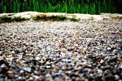 Die Straße von kleinen Steinen Lizenzfreie Stockbilder