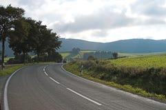 Die Straße zu den Hügeln Stockfotografie