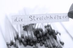 Die Streichhölzer, German word on a white note, matches on background. Learn new language, Die Streichhölzer, the German word for Matches written on a note stock photo