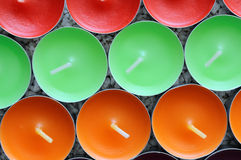 Die Struktur der mehrfarbigen runden Kerze Stockfotos