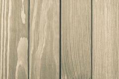 Die strukturierte Holzoberfläche der beige Farbe Stockbild