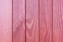 Die strukturierte Holzoberfläche der Rotweinfarbe Lizenzfreies Stockfoto