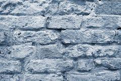 Die strukturierte Oberfläche einer alten Backsteinmauer Stockbilder