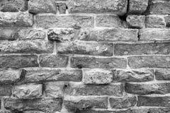 Die strukturierte Oberfläche einer alten Backsteinmauer Stockfotos