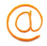 Die Symbol-eMail von einer orange Wolle Stockfotografie