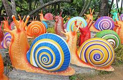 Die synthetischen riesigen Schnecken als Gartendekoration in tropischem Garten Nong Nooch in Pattaya Lizenzfreie Stockbilder