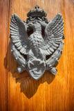 Die Tür zum Haus mit dem Emblem Lizenzfreies Stockfoto