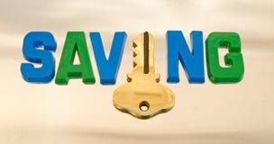 Die Taste zur Einsparung. Lizenzfreies Stockbild