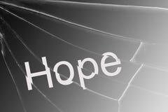 Die Text Hoffnung auf dem defekten Glas Konzept der Verzweiflung und der Hoffnungslosigkeit lizenzfreies stockfoto