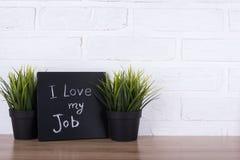 Die Text ` I Liebe mein Job ` auf einer Tafel Stockfotografie