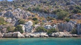 Die versunkenen Ruinen auf der Insel von Kekova Dolichiste der alten Lycian-Stadt von altem Simena, wurden durch ein Erdbeben zer stockfoto