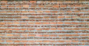 Die Wände zwischen der Schaffung mit orange Ziegelsteinen, Hintergrund lizenzfreie stockfotografie